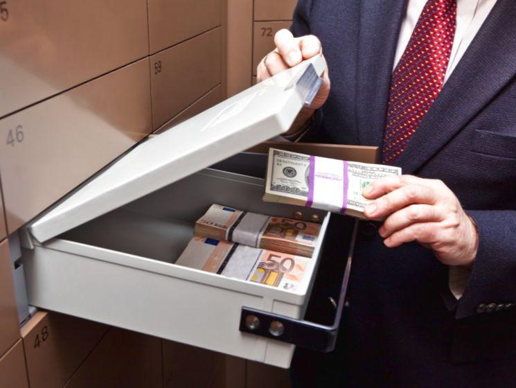 Как происходит передача средств через банковскую ячейку при покупке квартиры