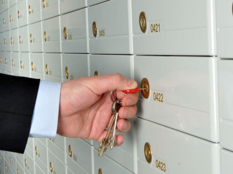 Как происходит передача денег через банковскую ячейку при покупке квартиры